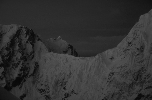The Rooster Comb and Mt. Huntington at midnight from the summit of Pk ...