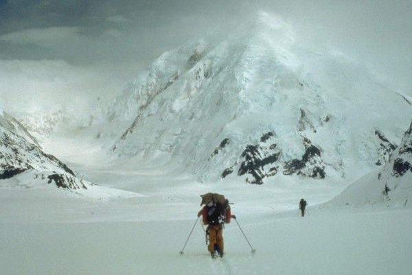 The main Kahiltna Glacier, and crowds of climbers ahead. Mt Crossen in...