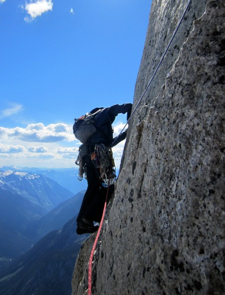Alec traversing out on the crux 5.10 face traverse of P18. Alec was to...