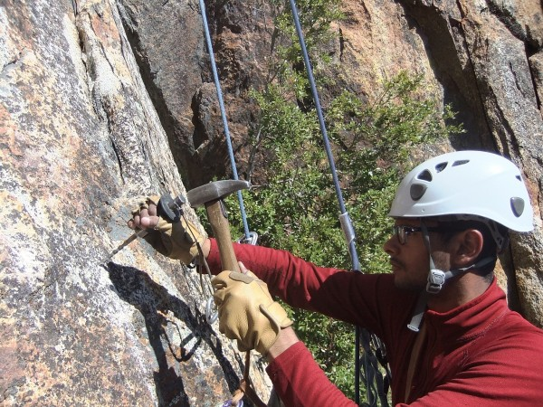 Job drilling anchor #5 on the Middle Cathedral East Face rap route, <br/> ...
